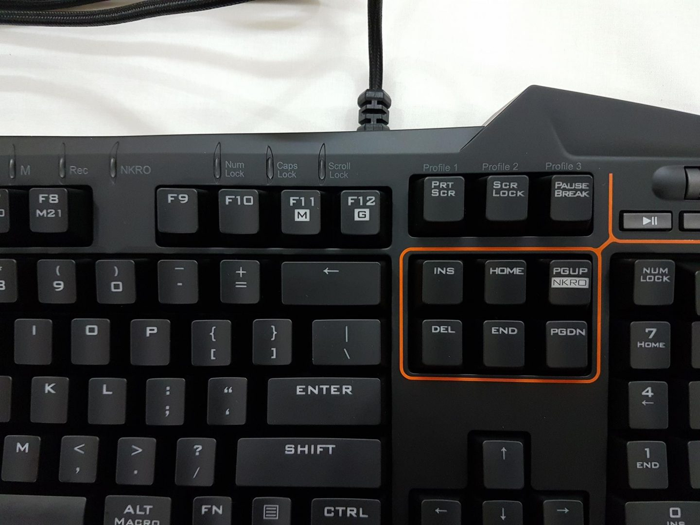 Asus strix tactic pro mechanical gaming keyboard review enostech on the far right side of the keyboard we have the keypad with num lock and sign keys implemented in the straight lined edges as compared to the less than biocorpaavc Images